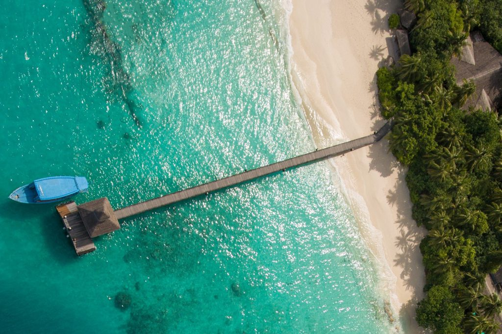 Reethi beach jetty and blue boat - Maldives
