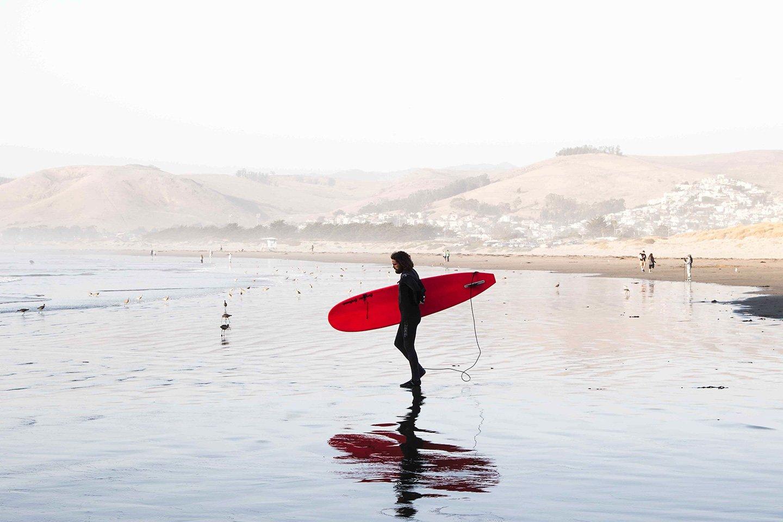 Surfer at Morro beach