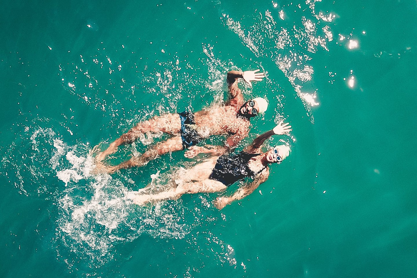 Couple swimming in the ocean