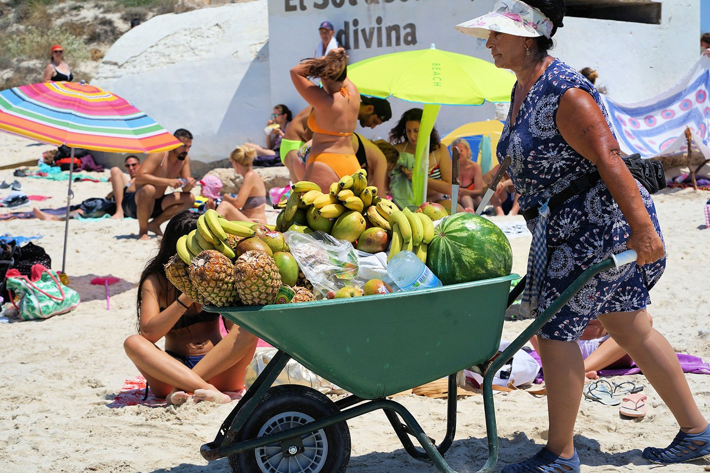 Lady selling fruit at the beach