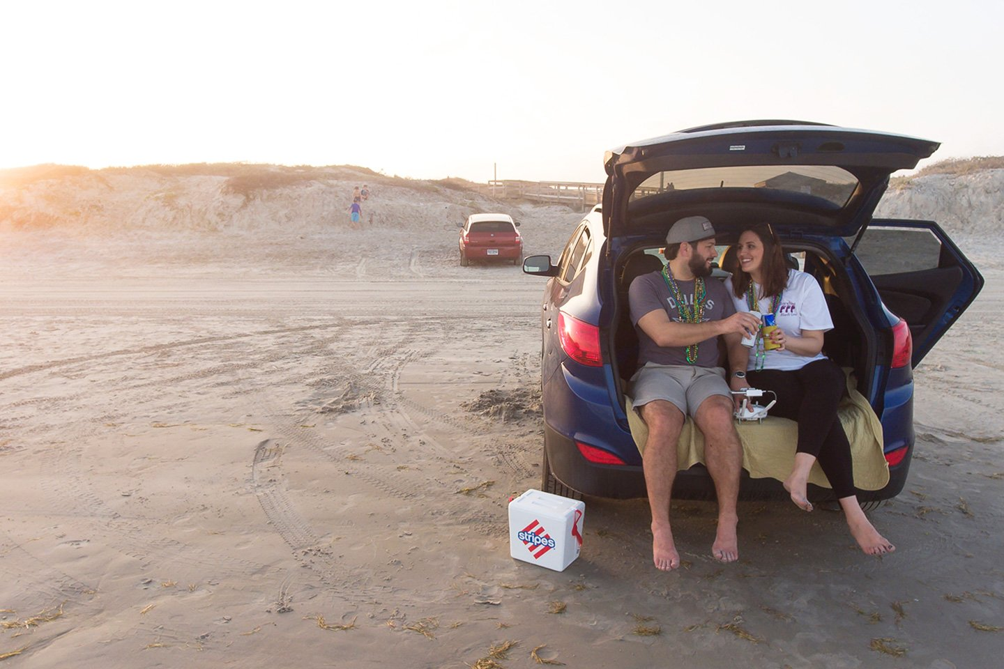 Couple with cooler at the beach