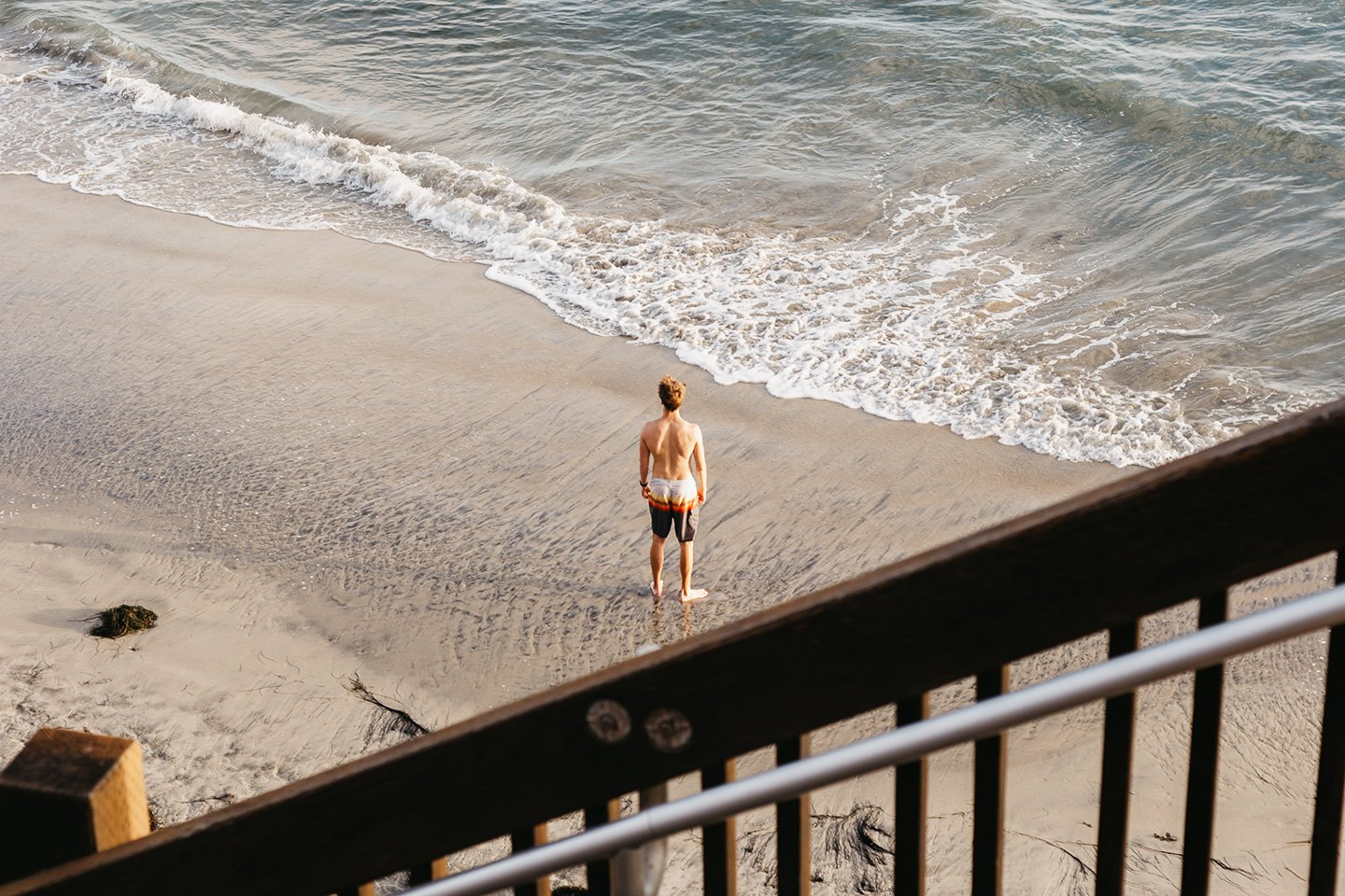 Boy standing near the water at swami beach