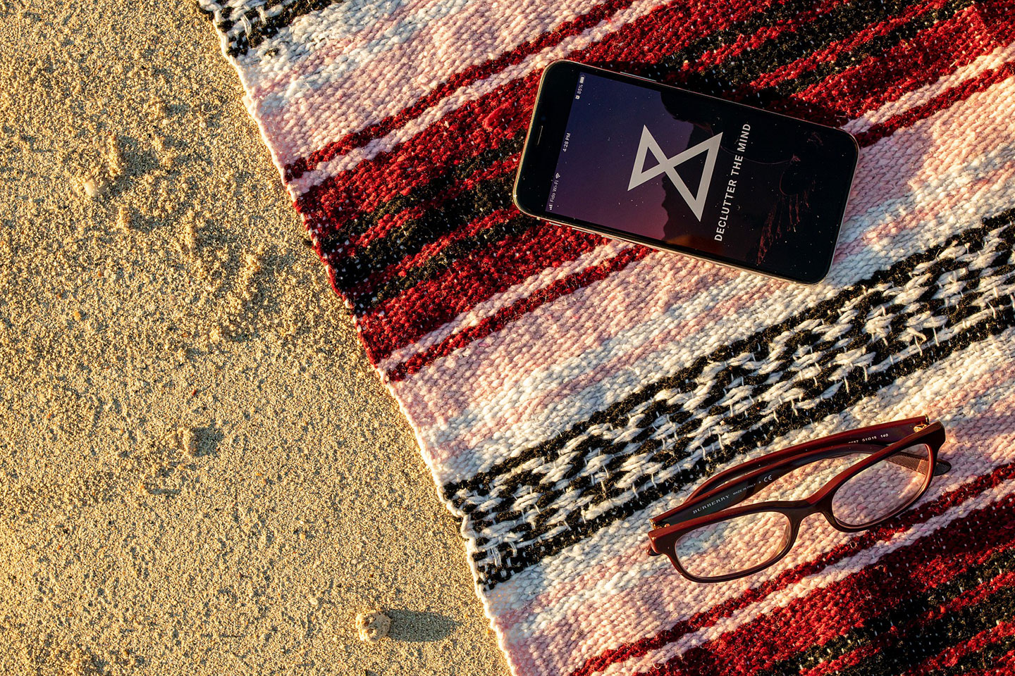 Smartphone on towel at the beach