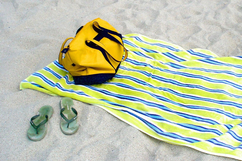 Yellow bag on a towel